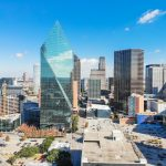 Aerial view of downtown Dallas, Texas during sunny autumn day with colorful fall foliages